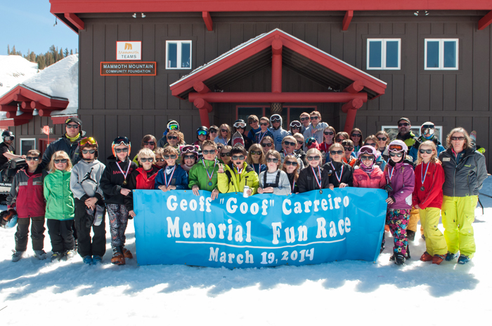 """Competitors who raced in the fourth annual Geoff """"Goof"""" Carreiro Memorial Fun Race pose for a group photo wearing their participation prize,  new dark glasses."""