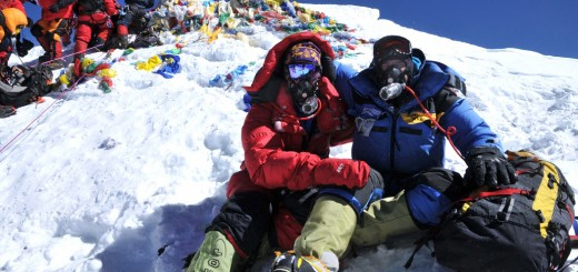Kurt Wedberg (right) and client Fred Simmons (left) sit on the summit of Mt. Everest.