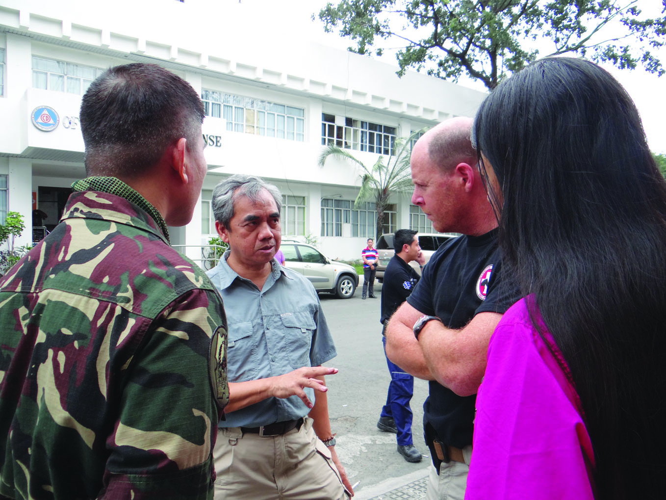 At the Office of Civil Defense in Manila: Major Manuel Garcia, Head of Joint Operations Disaster Response (PI), Philippine Secretary of National Defense Voltaire Gazmin, Dr. Mike Karch and new MMM member Jocylane Dinsay (RN) of Los Angeles. Photo courtesy: Katie Dease.