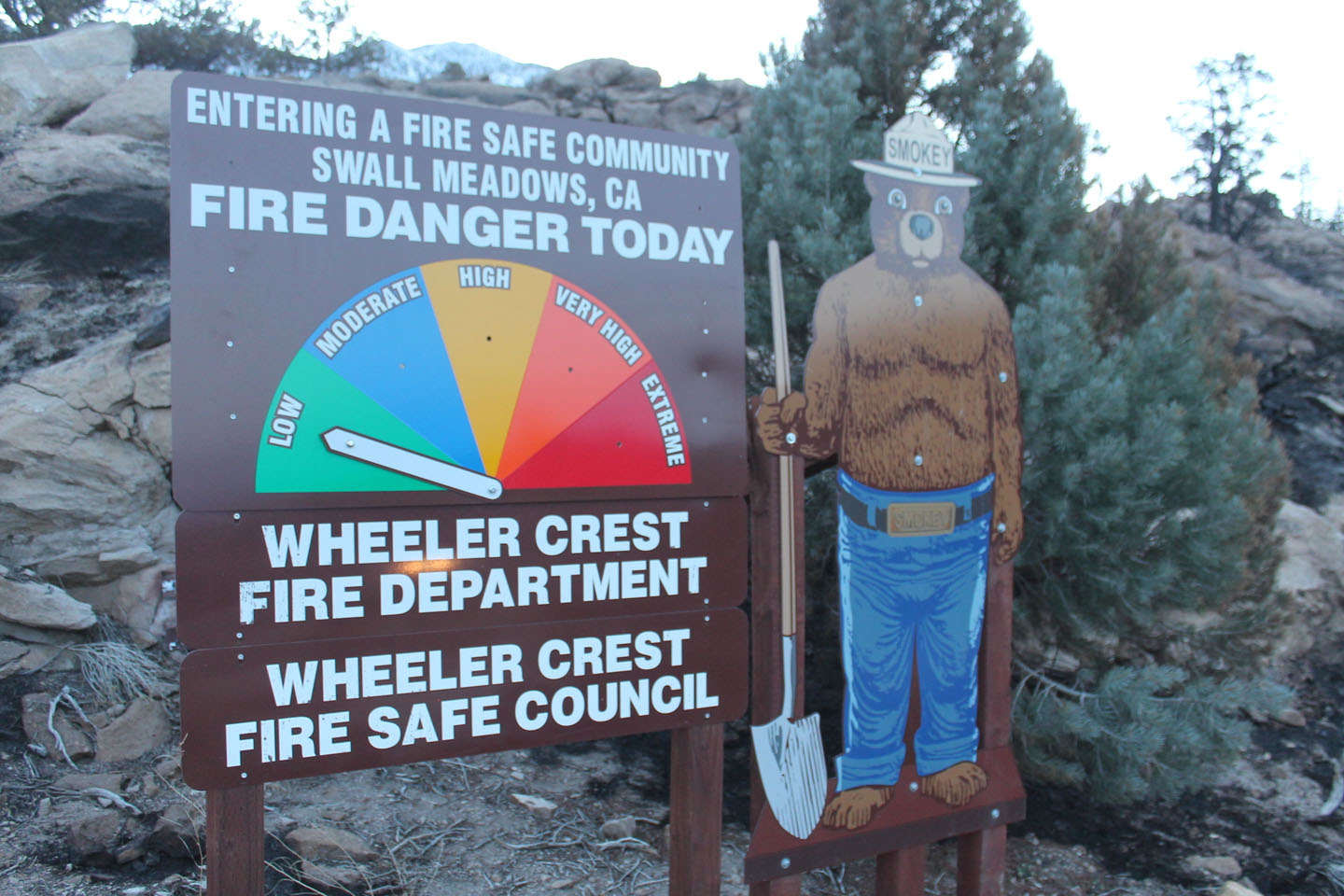The sign entering Swall Meadows which ironically indicated fire danger as low on Friday.