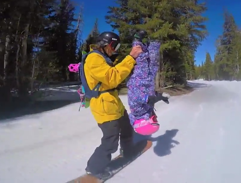 Klassen dangles daughter Kinsley in their popular YouTube video.