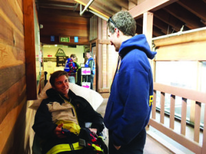 MHS student Ian Ezell with a local paramedic. Photo courtesy: Chris Leonard.