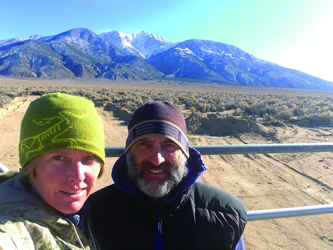 Delinda Briggs and Jeph Gundzik stand in front of the entrance to their new ranch in Queen Valley, Nevada. Photo courtesy: Delinda Briggs.