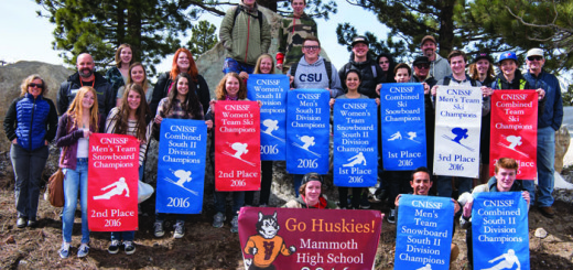 Members of the Mammoth High School Ski and Snowboard Team hold this season's banners. Mammoth defeated Davis 1879 to 1869 in the State Championships held March 7-10.